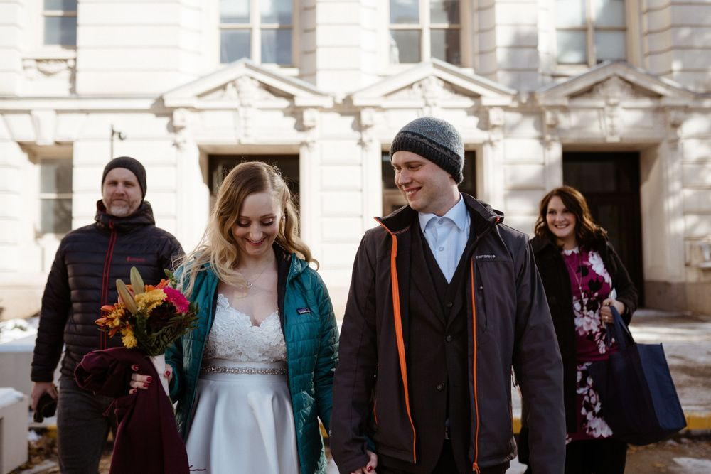 bride-groom-walk-out-of-court-house-elopement-polk-county-courthouse-desmoines-iowa-raelyn-ramey-photography