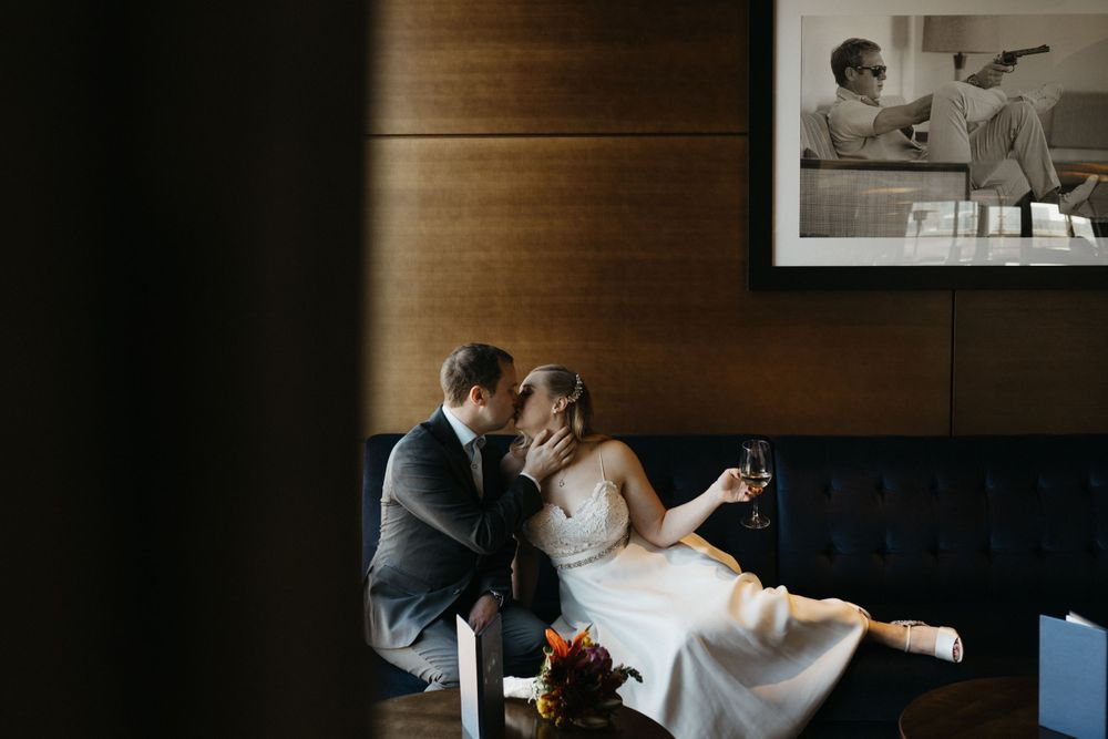 bride-groom-kissing-at-the-republic-on-grand-elopement-desmoines-iowa-raelyn-ramey-photography
