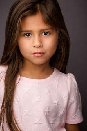headshots nyc of adorable kid actress in pink star dress