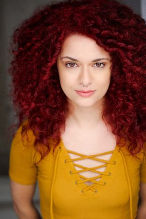 headshots nyc of woman with red curly hair