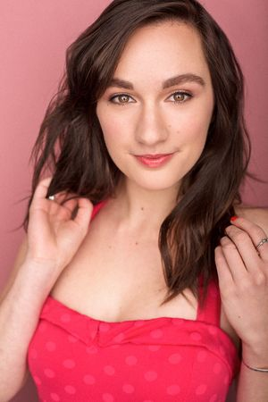 headshots nyc of actress erica lee bigelow in a pink dress