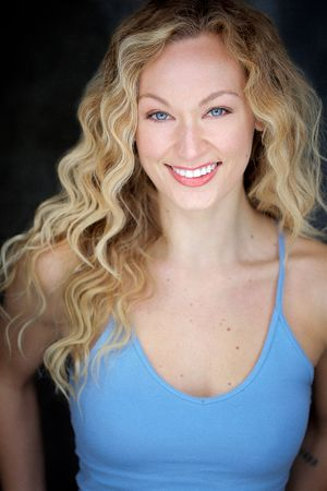 heashots nyc of sarah louise kane with blonde curly hair