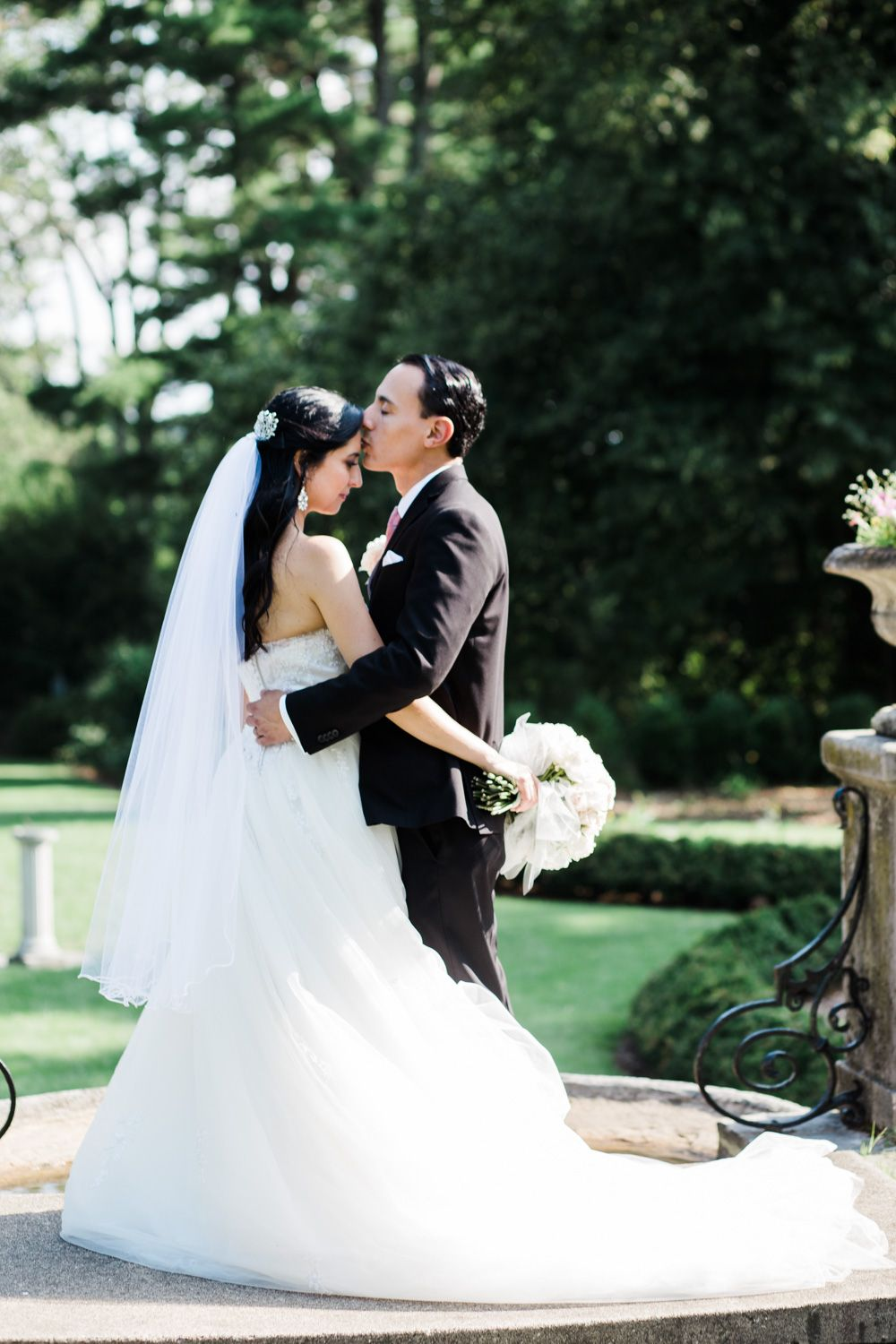 Bride and groom share a quiet moment at the New Jersey Botanical Garden