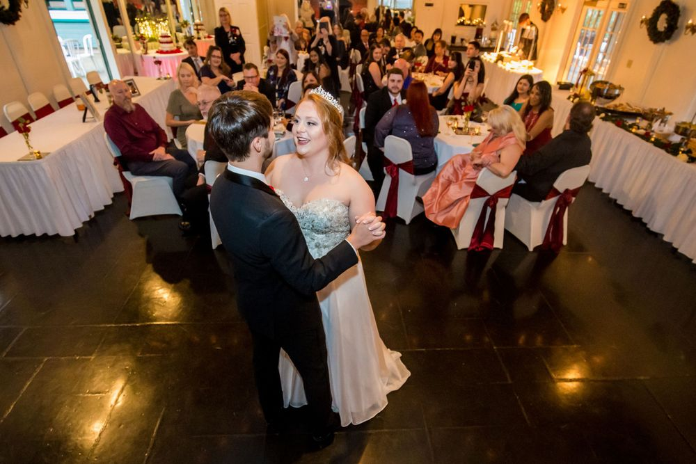 Bride and groom share their first dance during a wedding reception at Winter Green Woods in Lexington, SC