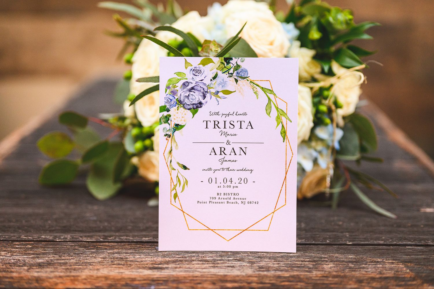 invite details on wooden plank